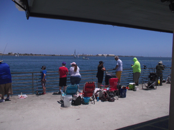 A perfect sunny day on the Shelter Island Pier. Across the bay you can see North Island Naval Air Station.