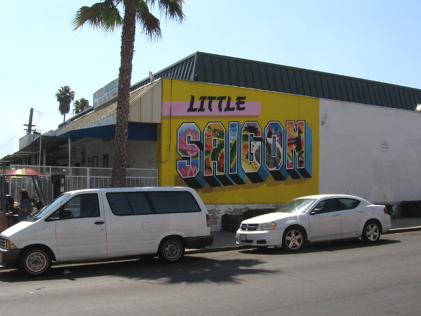 Little Saigon postcard mural on the side of Sin Lee Food Whole Sale on El Cajon Boulevard.