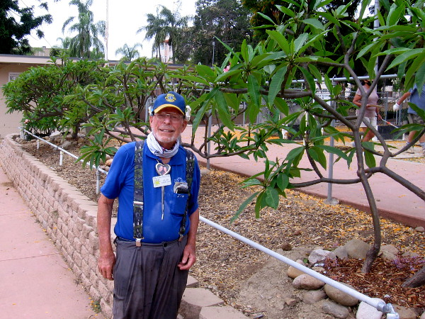 Dr. Jim Knott helps to tend the beautiful San Diego Memorial Plumeria Garden.