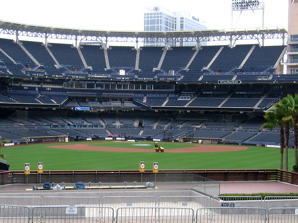 Petco Park is newly painted and empty as the grounds crew prepares the field for Padres baseball. No fans will be in attendance this shortened season.