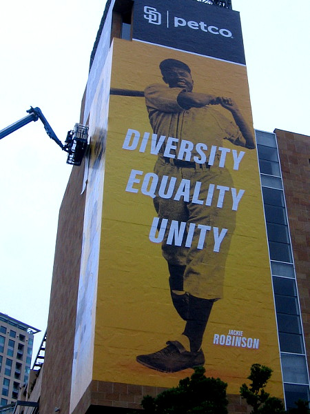 Large wrap on Petco Park celebrates Jackie Robinson. Diversity. Equality. Unity.