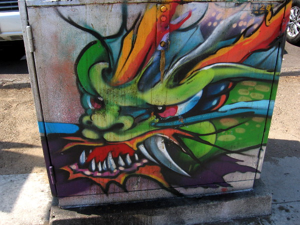 I love this dragon street art. I had to add contrast to many of these photos, because much of the artwork has been faded by time and weather.