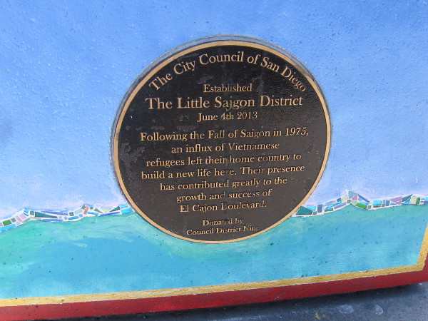 Plaque on side of the planter indicates The Little Saigon District was established on June 4th, 2013. Vietnamese refugees have built a new life here.