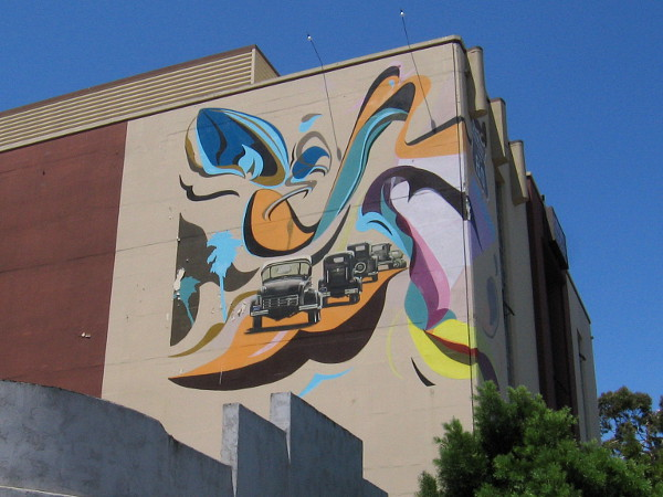 Mural in City Heights depicts vintage cars heading down El Cajon Boulevard.
