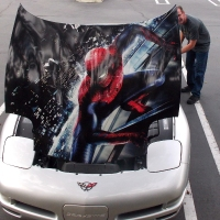 Spider-Man on the hood of a Corvette!