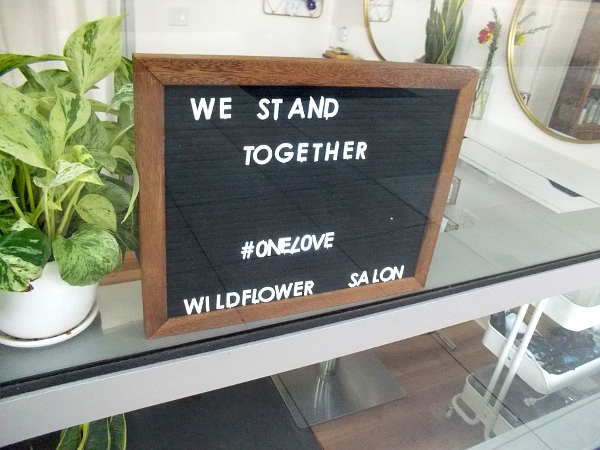 We Stand Together in the Wildflower Salon window.