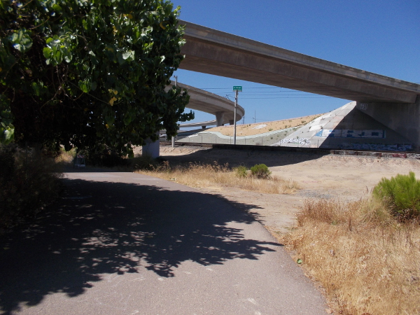 Turning a corner, about to go under a ramp from I-5 to U.S. Route 54.