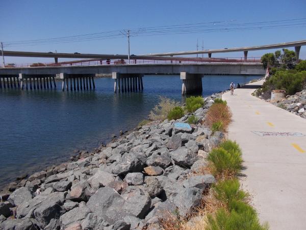 I begin walking west toward various bridges.