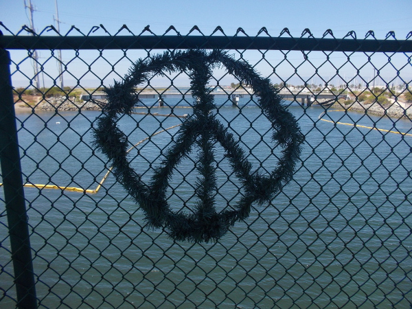 Someone made this cool peace sign out of some artificial wreath material.