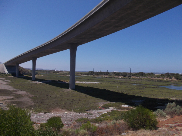 Freeway ramp swings south over part of San Diego Bay National Wildlife Refuge.