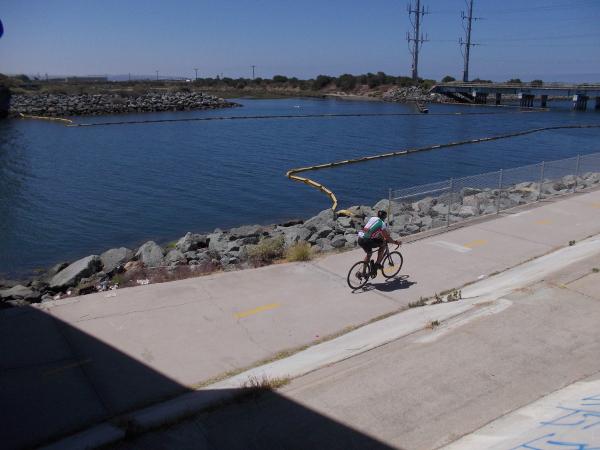 Biking west along the river channel.