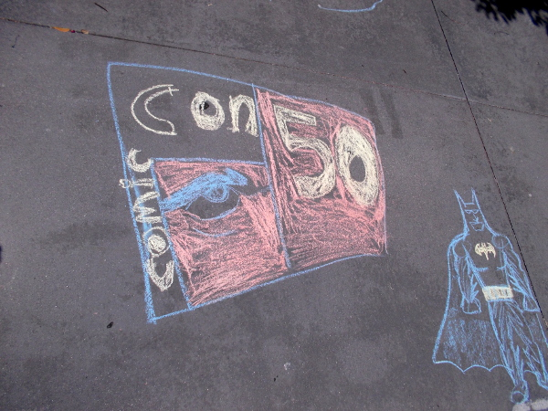 Chalk art reminds passersby in Gaslamp Square that 2020 is the 50th anniversary of San Diego Comic-Con. This year, due to the coronavirus pandemic, the event is being held entirely online.