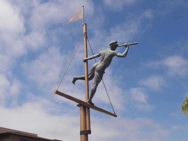 Sculpture of sailor on mast with spyglass, by artists T.J. Dixon and James Nelson, at San Diego's Silver Gate Yacht Club on Shelter Island.
