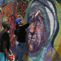 You can help restore murals around San Diego!