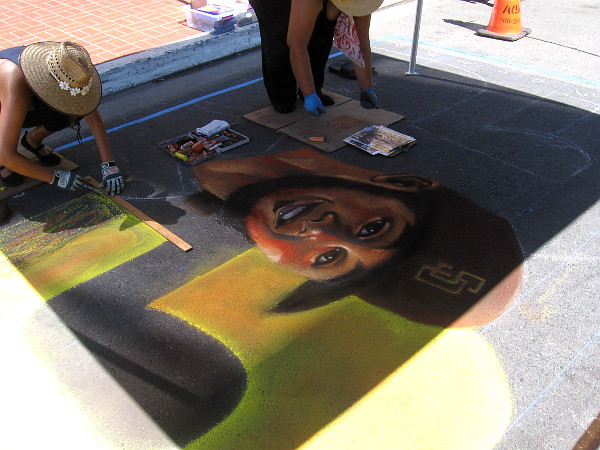 Cecelia Linayao produces Padres baseball chalk art in the Gaslamp Quarter during the first weekend of the 2020 season.