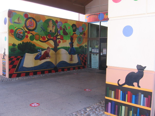 Colorful artwork that encourages reading greets visitors to the Vista Library.