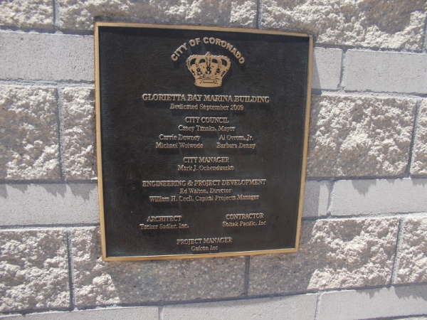 Plaque near stairs to outdoor second level of the Glorietta Bay Marina Building.