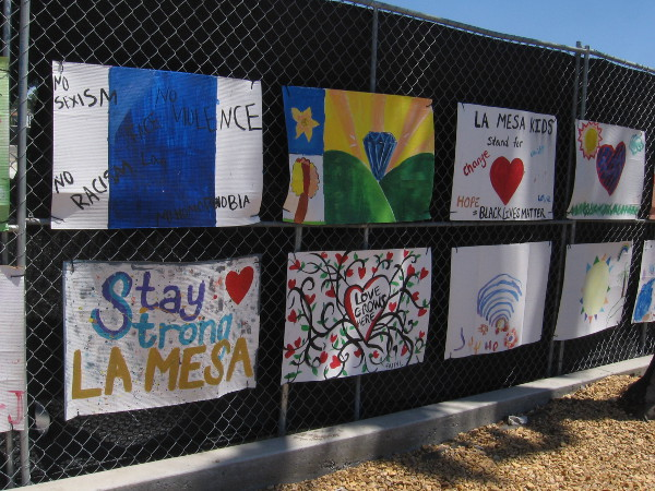 Positive messages of love and equality on a fence in La Mesa.