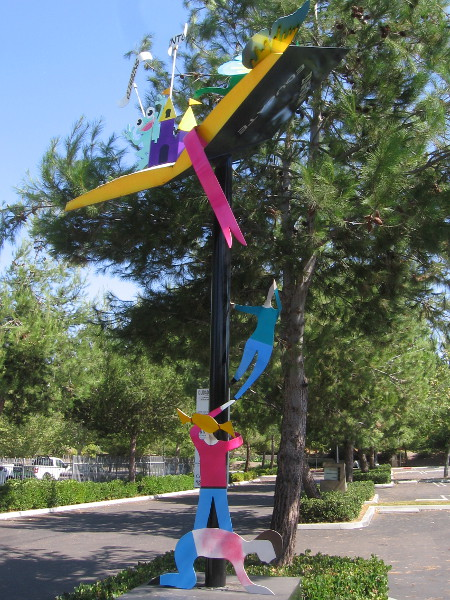 Sculpture at library's parking lot entrance. Climbing into Adventure, by Rick Randall and Jaydon Sterling-Randall, 2012.