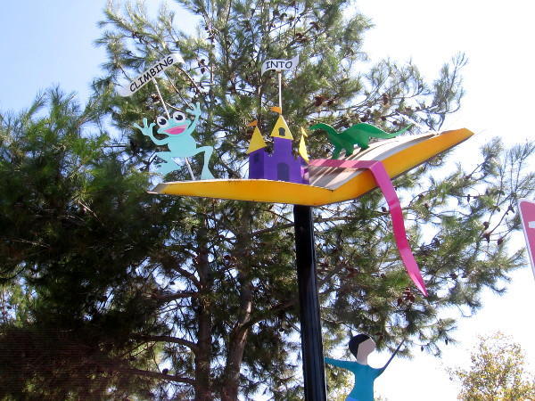 Up in the sky are many colorful wonders toward with the children together climb.