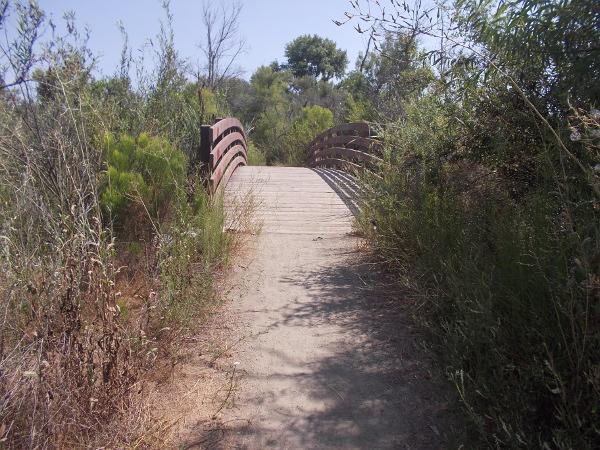 Approaching a footbridge that spans the San Diego River.