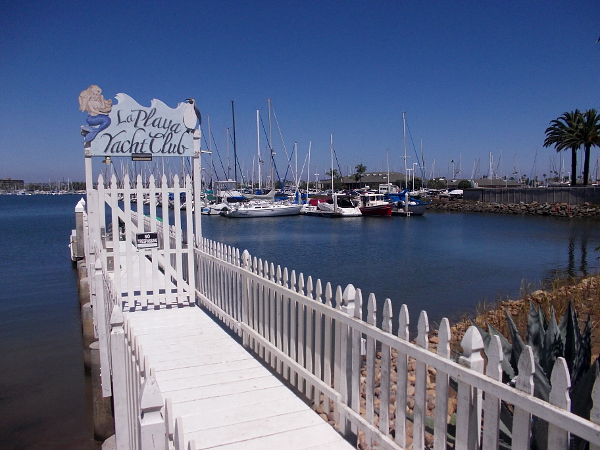 The short pier of the modest La Playa Yacht Club. Beyond lie boats of the much larger Southwestern Yacht Club.