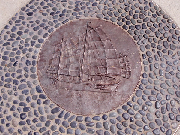 Artwork in the sidewalk depicts the three-masted Chinese junk Sun Yun Lee, that was built on Point Loma in 1884.