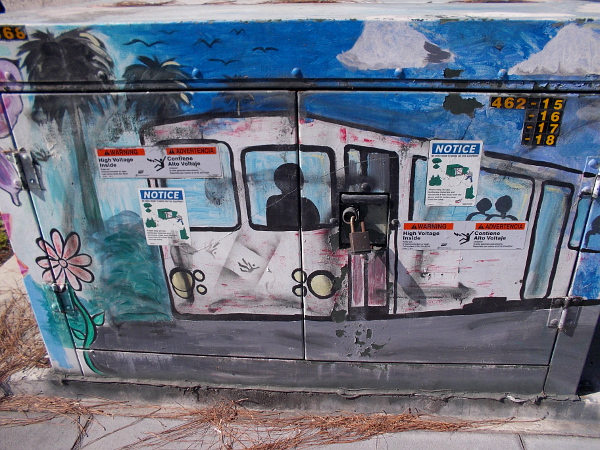 Trolley driver emerges from a painted electrical box.