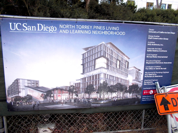 Banner on fence shows rendering of the new North Torrey Pines Living and Learning Neighborhood.
