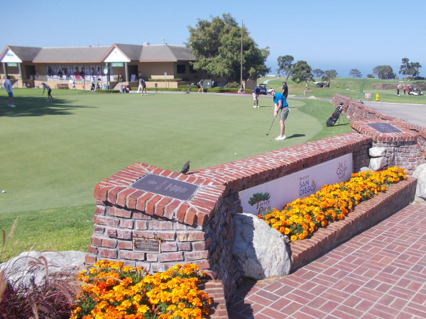 Plaques along one side of a practice putting green at Torrey Pines Golf Course.