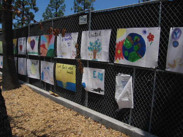 Artwork along the fence represents the optimism of La Mesa residents.