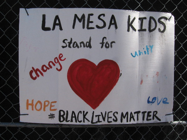 La Mesa kids stand for change, unity, hope, love.
