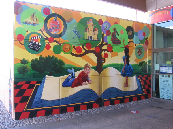 A fantastic mural near front door of the library. Kids activate their imagination and ambitions with a book.