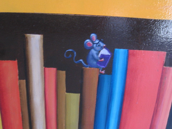 Even a painted mouse in the mural is reading a tiny book.