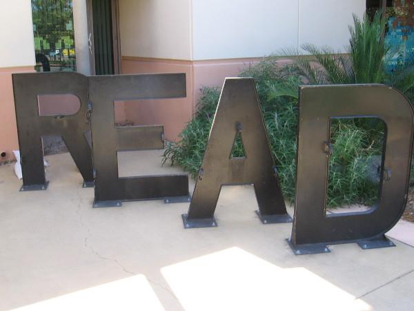 Bike rack spells READ.