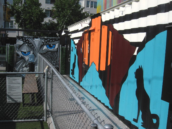 The mural on the right with the two dogs was painted last week. You can find it behind Quartyard's fenced dog area.