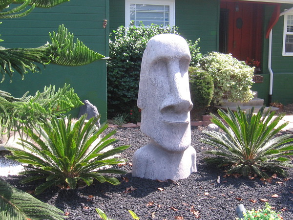 Easter Island head in a front yard.