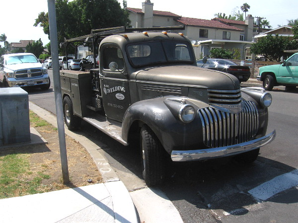 Check out this cool old truck. A guy with the welding company talked to me near a sculpture of a bison in his lot near the sidewalk, but I didn't think to snap a photo of it before I had resumed walking. Bummer.r.