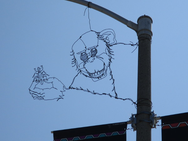 Fantastic wire art hung from a street lamp at Main Street and Beardsley Street in Barrio Logan!