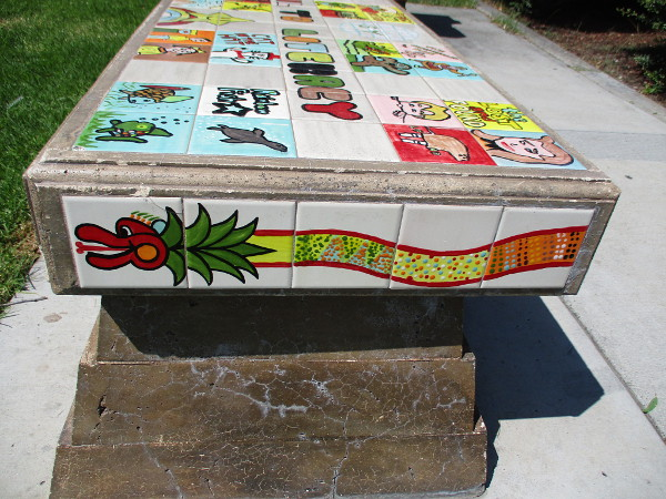 Quetzalcoatl on the side of one bench.