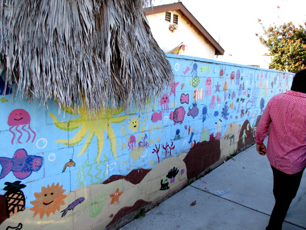 Another fun mural beside the parking area was painted years ago by happy kids. I've never seen so many smiling sea creatures!