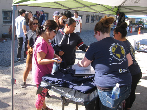 Volunteers for a community clean-up gather in City Heights for the Global Day of Caring.