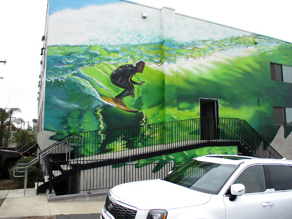 The mural was painted from a photo taken by surf photographer Todd Glaser of pro-surfer Rob Machado, both Cardiff residents.