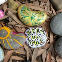Stones painted with love, optimism, dreams.