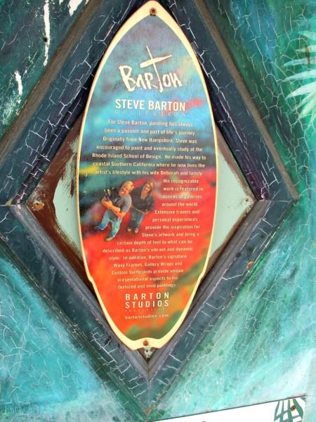 Sign on mural describes Southern California artist Steve Barton.