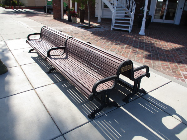 A bench at the south end of Maple Street Plaza on Grand Avenue.