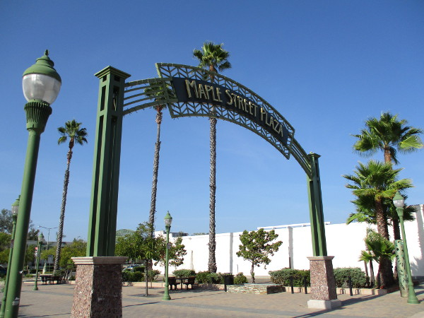 Landmark sign arches above the south end of Maple Street Plaza in Escondido.