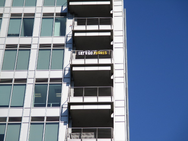 Banner on high balcony overlooking Petco Park's outfield proclaims: Let's Go Padres.