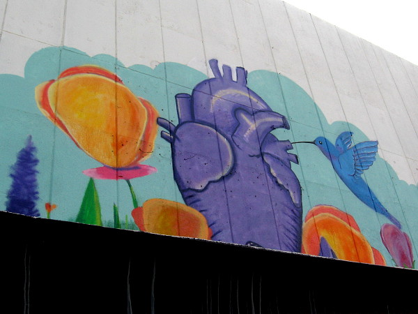 Colorful art painted high on a building that is for lease on Chula Vista's Third Avenue.