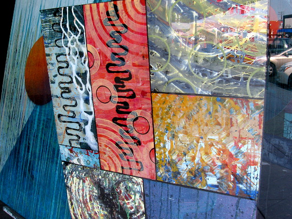Abstract paintings by Rich Walker in the window of Art on Third.